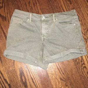 Green/olive jean shorts.